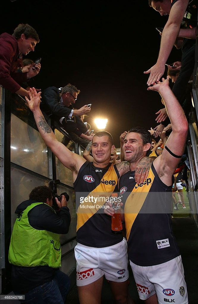 Dustin Martin (L) and Chris Newman of the Tigers celebrate the win during the round one AFL match between the Carlton Blues and the Richmond Tigers at Melbourne Cricket Ground on April 2, 2015 in Melbourne, Australia.