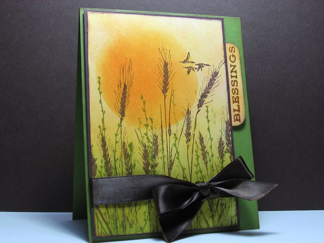handmade card: Harvest Blessings by cardrageous (Robin) ... beautiful sponged color in background ... huge sun ... silhouette wheat stamped in black ... other plants stamped in green ... gorgeous carcard ...