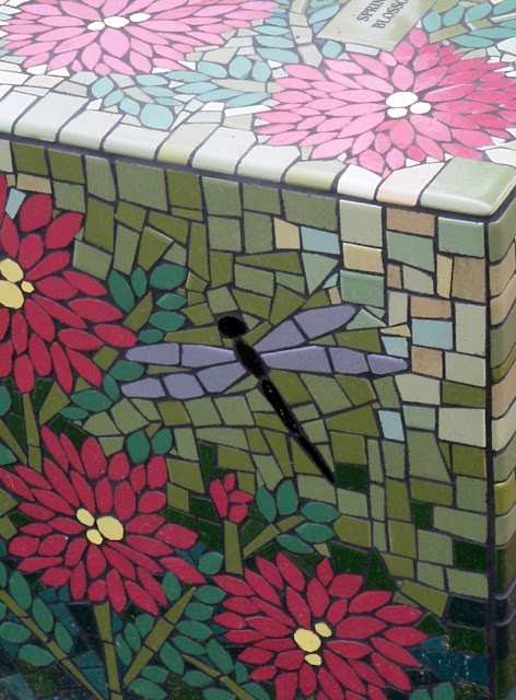 This site shows several lovely mosaic pieces made by Crystal Thomas that were commissioned for a garden. Worth a look if you do mosaic work. (http://getcottage.blogspot.com/2012/09/a-mosaic-garden.html).