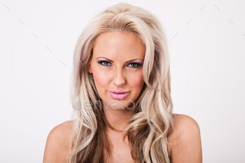 Beautiful blonde woman with pink makeup and large lips