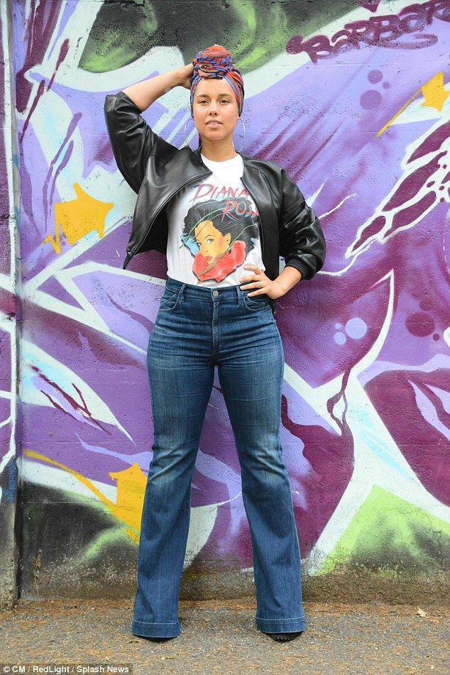 Supreme style: The 35-year-old rocked a bold Diana Ross print t-shirt, flared jeans and a ...
