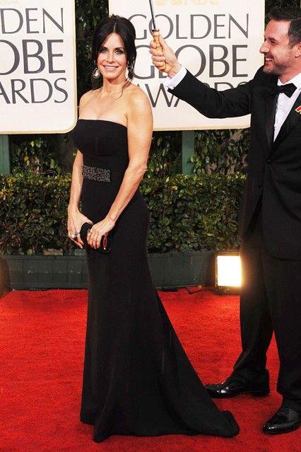 2010 - Courtney Cox Arquette in Victoria Beckham, and husband David Arquette