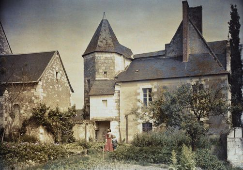 Near Tours, Centre. People walk around Le Louroux, a castle used as a farm. Photographer: JULES GERVAIS COURTELLEMONT