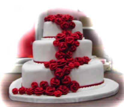 Red roses cascade down an otherwise simple white fondant layer cake, in a rush of understated elegance. The red roses add a sense of romance and passion when contrasted against the white background, but for different yet equally pleasing effects, any other accent color could be used. You can also consider a different color for the wedding cake itself. If you look closely, you'll notice that the layers of this cake are actually heart-shaped, however, you could ask your cake designer to modify…