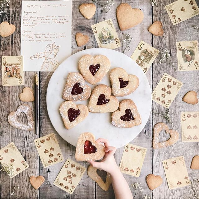 The Queen of Hearts: She made some tarts: All on a summer's day; The Knave of Hearts: He stole those tarts And took them clean away. . In this case the tarts were made - with love - for the person who ended up eating most of them (or rather licking out the jam and then leaving the rest of the biscuits on the table) so stealing is probably too strong a word - even if we were supposed to wait until Valentines Day. #whpwithlove . But I love the iconography of the Queen of Hearts especially in…