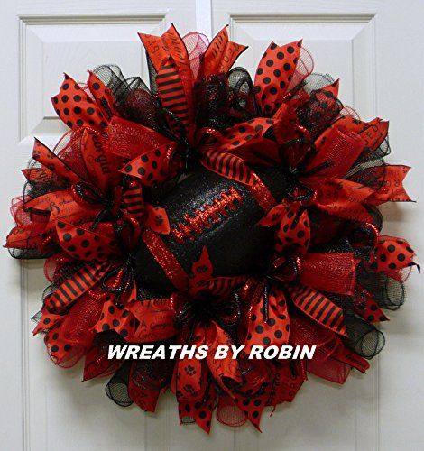 Georgia Sports Wreaths, Georgia College Wreaths. BOXED AND READY FOR SHIPPING! The perfect wreath for the perfect Georgia fans! Order your wreath to show your support for your favorite football team. This wreath was made on a deco mesh form with three colors of deco mesh. Lots of ribbon has been added with a glittery football in the center. This wreath is approximately 24 x 24 x 7 and will awesome on your front door. Thank you for shopping with Wreaths by Robin!.