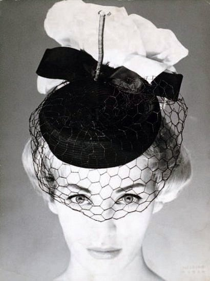 Model is wearing hat by Jean Barthet, photo by Harry Meerson, 1950.   Oh, love it!  I still have one in navy with velvet trim....much like this in front.