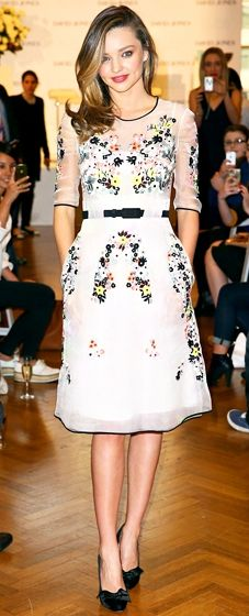 Miranda Kerr wears a white dress with floral embrodiery to the Kora Organics Media Call