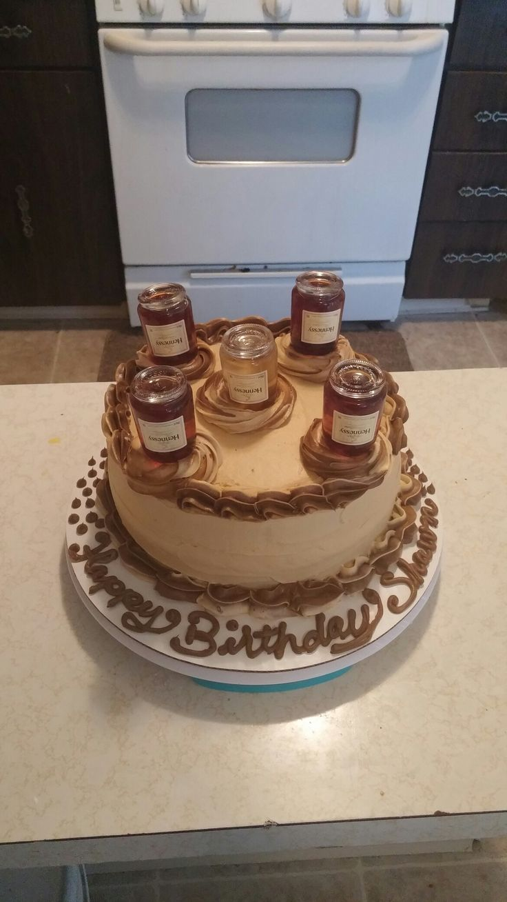 Hennessey Infused Cake With Mini Henney Bottles On Top