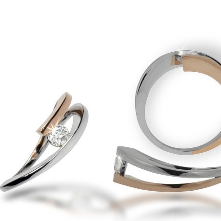 Right now: this one, but with a princess cut.  http://www.private-diamond-club.com/270-775-thickbox/tension-set-diamond-engagement-ring-brunelle.jpg
