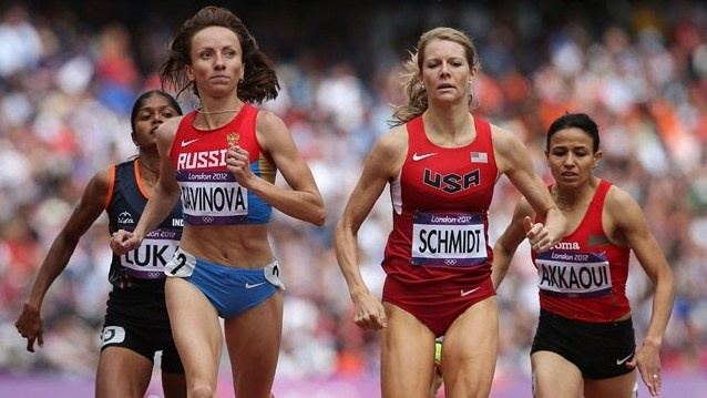 Alice Schmidt of the United States leads the pack in the women's 800m round 1 heats on Day 12 of the London 2012 Olympic Games.