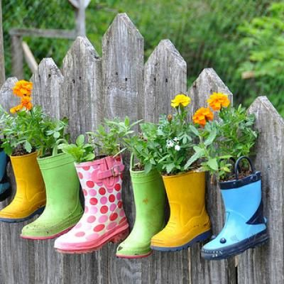 "rain boot garden!! I rescued a few mismatch galoshes from the thrift store, and have a few with holes my kids wore out (with love:) Can't wait to plant our own ""boot garden"" in the back yard this year! ~megan"