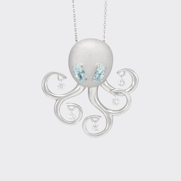 octopus pendant in White gold with diamonds and topaz