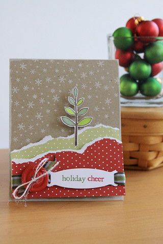 kraft card with a simple winter scene ... snowflake filled sky ... torn paper hills ... popped little tree ... sweet ...