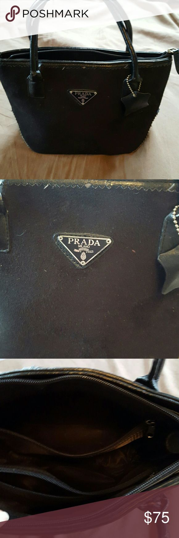 Prada purse Black. 2 pockets inside and a cell phone pocket. Shows some wear. Leather and velvet. Prada Bags