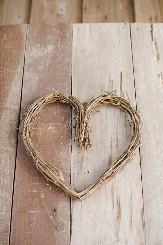 A simple heart of grapevine accented the barn-like doors on the waterside of The Cotton Dock.
