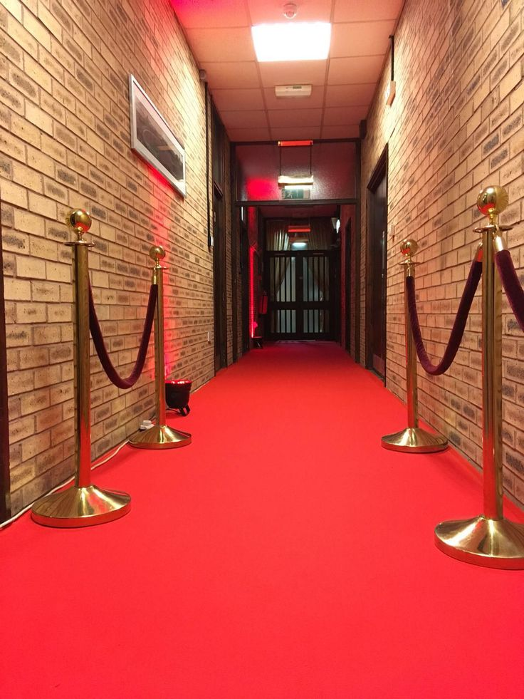 The grand entrance to the function room, lined with gold poles and rope