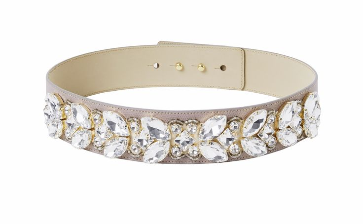 Crystal belt taupe! Sparkle like a movie star in these beads and crystals which make any outfit an extremely glamorous one! Each stone is applied by skilled hands. The belt is made out of genuine leather by a manufacturer who has been producing leather accessories since 1977! It features a hidden double button closure and can be worn with any piq look.