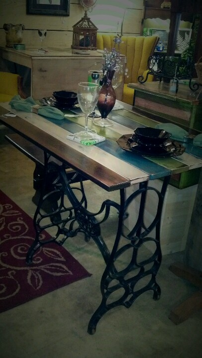 Repurposed Hunter sewing machine base and futon slates. Distressed in several colors.