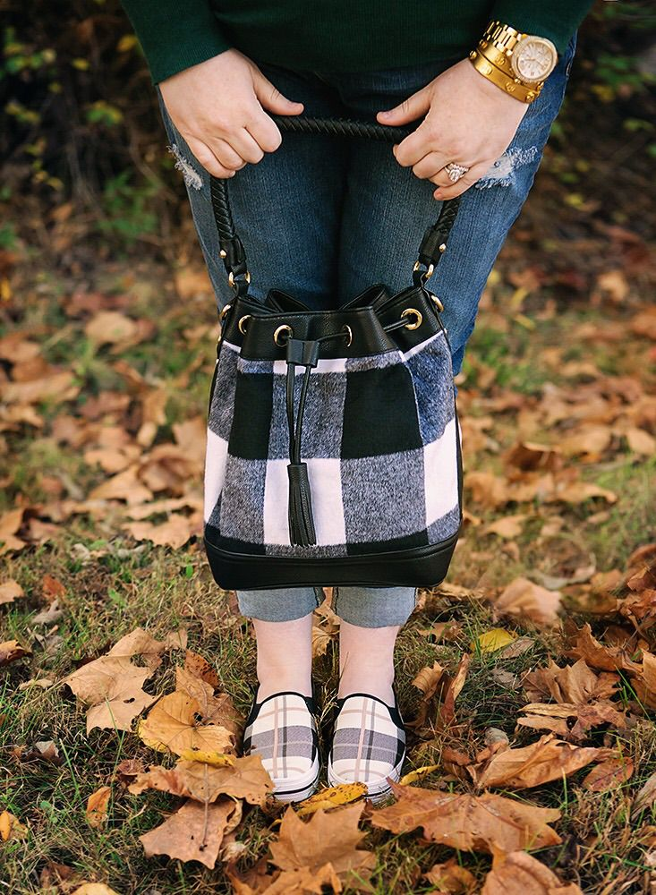 This bucket bag is less than $40 at Target and perfect for on trend fall fashion! Also living the plaid Kate Spade Keds slip ons. Comfortable and chic.