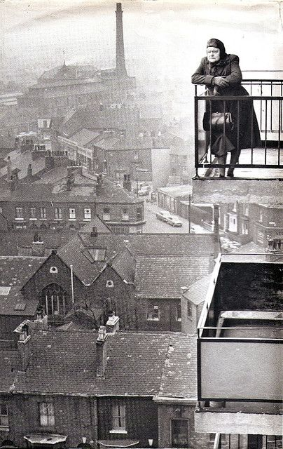 Iconic photo of actress Violet Carson as 'Ena Sharples' the Coronation Street character  looking out over the early 60's industrial landscape of Manchester.