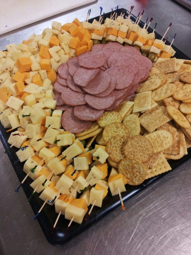 Love the cheese stackers.Now that's a cheese, cracker, and sausage tray for