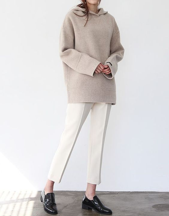 Rock a beige hoodie with white tapered pants for both chic and easy-to-wear look. Make black leather loafers your footwear choice to va-va-voom your outfit.   Shop this look on Lookastic: https://lookastic.com/women/looks/beige-hoodie-white-tapered-pants-black-leather-loafers/23459   — Beige Hoodie  — White Tapered Pants  — Black Leather Loafers