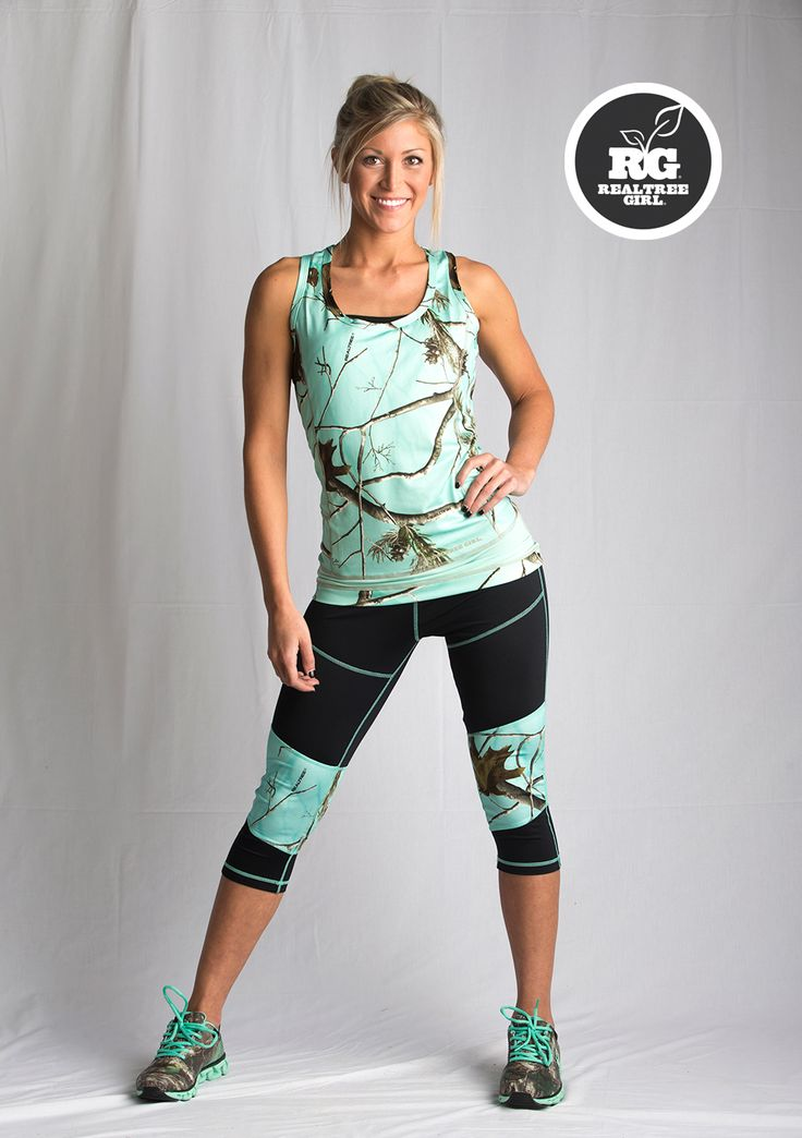 Pinkly smiling blonde in minty hunter camo racerback w/ matching black & camo capris, mint-laced runners