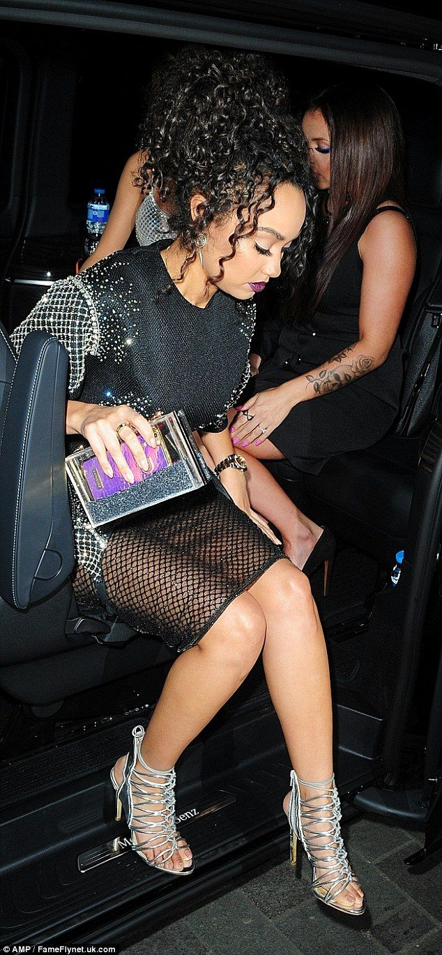 Matchy matchy: She accessorised with a Perspex silver clutch bag, flashing her purple phone cover