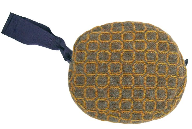 Isa small pochette in handwoven fabric nuba gold. gros grain handle