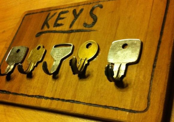 Key holder from keys - He secured the keys in a vice and carefully curled them by tapping them with a hammer, only breaking two in the process.