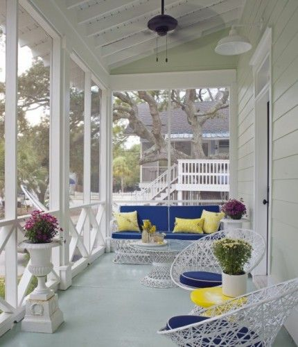 Love this screened front porch with vintage outdoor furniture!   Article - Houzz Tour: Sweet Georgia Summer Beach Home by Vanessa Brunner http://www.houzz.com