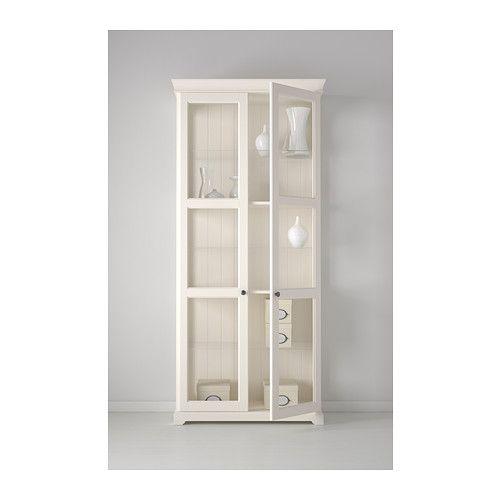 LIATORP Glass-door cabinet IKEA 3 adjustable glass shelves.  Adjust spacing according to your storage needs.