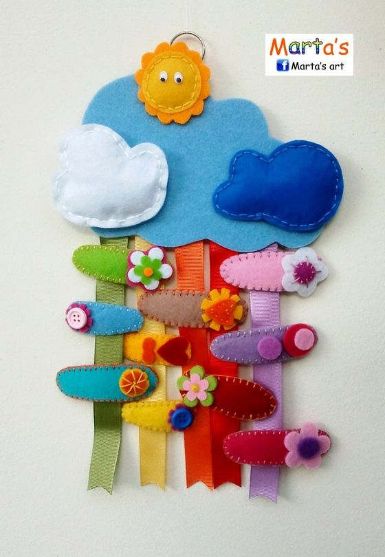 Felt hair clip organizer. So cute! But I would have to buy four different colours of ribbons for this...