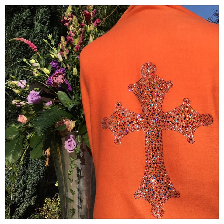 Crystal embellished orange cashmere and silk pashmina CROSS for the perfect luxury holiday outfit. Travel in style with an extra bit of sparkle. Also great to wear for any special occasion such as wedding, birthday, dinner party etc.