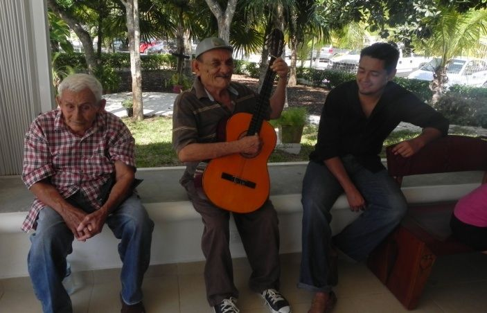 Guitar and song at Entertainment with Seniors activity. There is usually dancing and games in the outdoor palapa