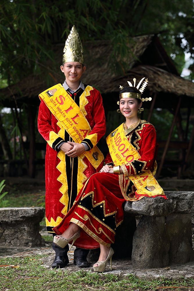 Traditional Nias dress often worn of weddings and official ceremonies. This is the Gunungsitoli tourism ambassadors of 2015. Photo by Bjorn Svensson. www.visitniasisland.com