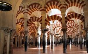 """The monument's official title has been """"The Cathedral of Santa Maria of Cordoba"""" since the 13th century — when the mosque built after the Moorish invasion of Spain in the 8th century was transformed into a cathedral after King Ferdinand III captured the city from the Moors.  The mosque itself had been built over a Christian Visigothic temple."""
