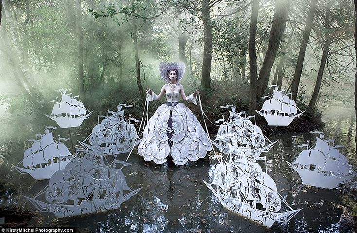 The Queen's Armada: A fantasy queen sales a fleet of the most delicate paper ships [Amazing backstory to this and other photos in a series: http://www.dailymail.co.uk/femail/article-2145760/Wonderland-Kirsty-Mitchell-heart-breakingly-beautiful-photographic-series-memory-extraordinary-life.html#]
