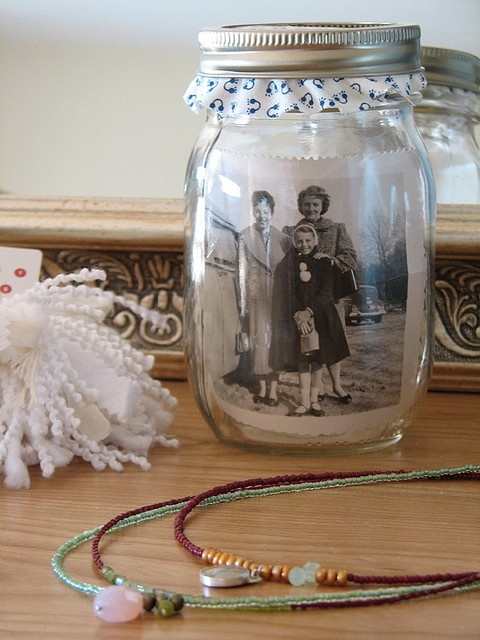 This would make a neat Wedding favor ... use a picture of the couple and have the ruffled fabric match the colors of the wedding.  You could even use jars with family pictures or vintage wedding pictures as center pieces.  LOVE this!