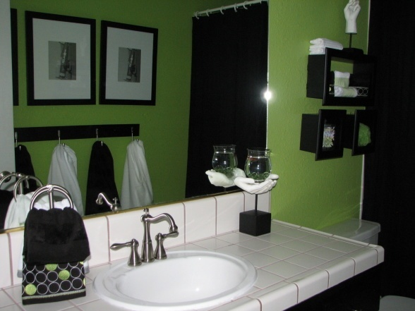 This gives me hope for our bright green bathroom. Love the towel holder! Never thought of that!