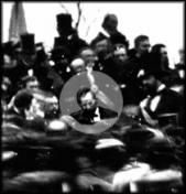Gettysburg Address Lesson Plans---High School level   Photo of Lincoln at Gettysburg dedication. Lincoln is highlighted in this image  in the middle of the crowd at the dais.