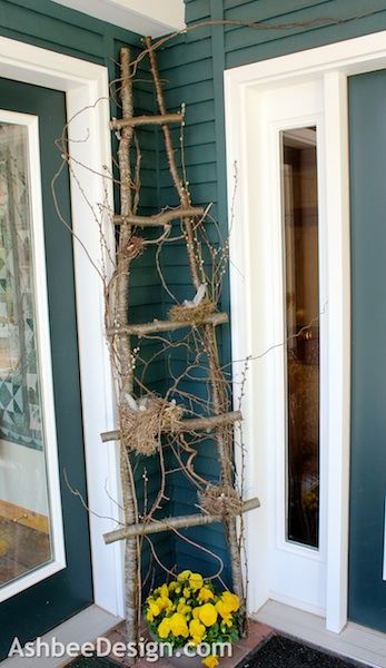 Bird's nest ladder for the entry way..simply use tree limbs...and bird nests you can gather outside (after families have moved of course) or from your craft store..