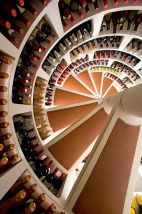 A compact discreet and stylish spiral staircase wine cellar that is  installed directly underneath the ground floor of any home.