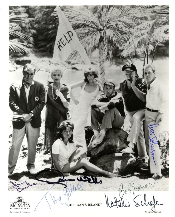 GILLIGAN'S ISLAND: Signed photograph by six of the main cast members of the 1960s American sitcom Gilligan's Island individually, comprising Bob Denver (First Mate Gilligan), Jim Backus (Thurston Howell III), Natalie Schafer (Eunice Lovelle Wentworth Howell), Tina Louise (Ginger Grant), Russell Johnson (Professor Ray Hinkley) and Dawn Wells (Mary Ann Summers). The image depicts seven of the cast standing and seated together outdoors on their uncharted island in the Pacific Ocean.