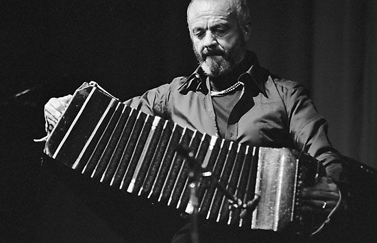Astor Piazzolla plays the bandoneón which is a square shaped accordion.