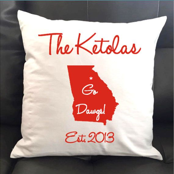 Dream Life Decor lets you add items to your home decor by giving you the option to personalize and make it custom to your taste. This custom 16x16 UGA Go Dawgs pillow adds the perfect finishing touch to your home to show your pride for your favorite team. These also make beautiful housewarming and hostess gifts especially during the holidays. Choose between Black or Red for your new game day decor  PILLOW DETAILS: This listing is for (1) 16x16 UGA Go Dawgs pillow cover with your name and…