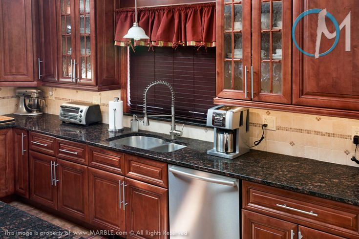 Cherries, Dark kitchen cabinets and Black granite countertops on