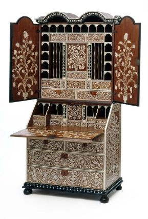 1725-1740 Indian Bureau-cabinet at the Museum of Fine Art, Boston - This piece looks absolutely stunning!  It's teakwood and ebony with ivory inlays, and shows how European furniture styles were adapted to the resources in new colonial lands.  Personally, I think it's British influence specifically: there has been an English presence in India since 1613, with the arrival of the East India Company.