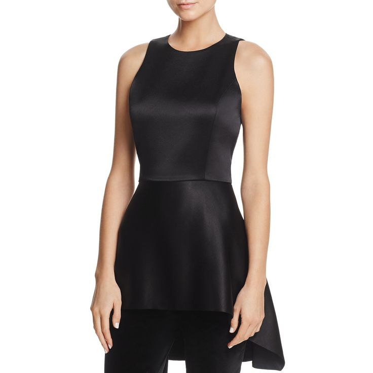 --evaChic--This Alice + Olivia Lizette Peplum Top is an essential eveningwear separate featuring an asymmetric angular hem, a fit & flare silhouette, and smooth satin fabric. The fashion-forward statement piece stands out as a shape but also due to its functionality. It definitely fills in the gaps in your special occasion wardrobe.      https://www.evachic.com/product/alice-olivia-lizette-peplum-top/